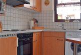 komplett eingerichtete Küche und Waschmaschine