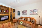 Wohnzimmer mit TV Flachbild un Bluray